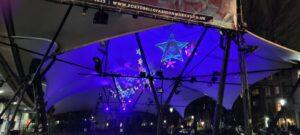 blue purple glow of handcrafted stars underneath Portobello canopy