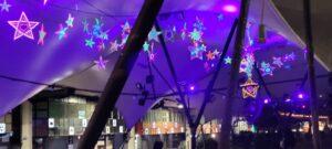 Purple glow illuminating fluorescent stars underneath a canopy