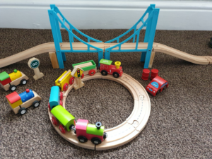 Wooden toy train and track set