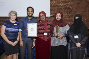 photo of a group with their award and certificate