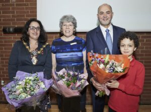 photo of a group with flowers at an awards ceremony
